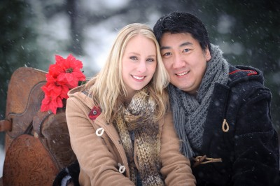 Two young beautiful engaged folks photographed in the snow