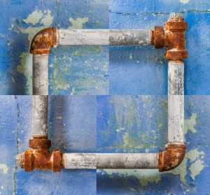 Blue and rusty pipes composite image