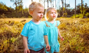 Kids standing in tall grass in the fall