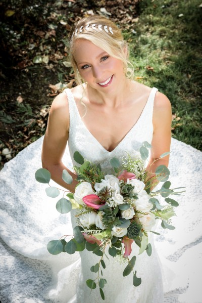 Bride holding a bouquet of flowers in wedding dress