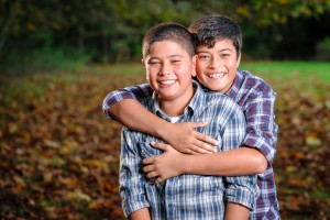 Two young brothers embracing for a portrait in fall colors