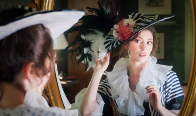 Old feather hat girl in mirror reflection my fair lady