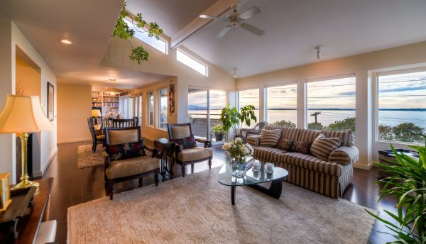 real estate photo living room with view of bellingham bay sunset