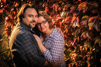 Engagement photo by colorful fall leaves