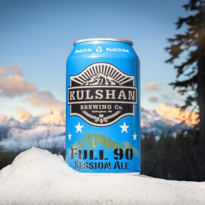 Kulshan beer can in the snow in the mountains baker