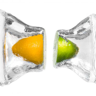 A composite of a lemon and lime splashing together