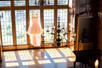 A wedding dress backlit by the sun at the Lairmont
