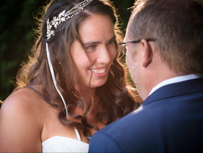 A bride looking longingly into grooms eyes at weeding close up