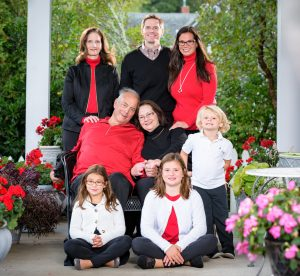 Professional Photo of a family on the porch at Christmas